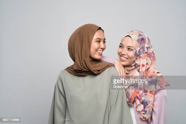 face to face with my bestie - malay hijab stock photos and pictures