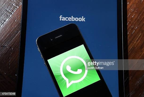 Facebook and WhatsApp logos are displayed on portable electronic devices on February 19 2014 in San Francisco City Facebook Inc announced that it...