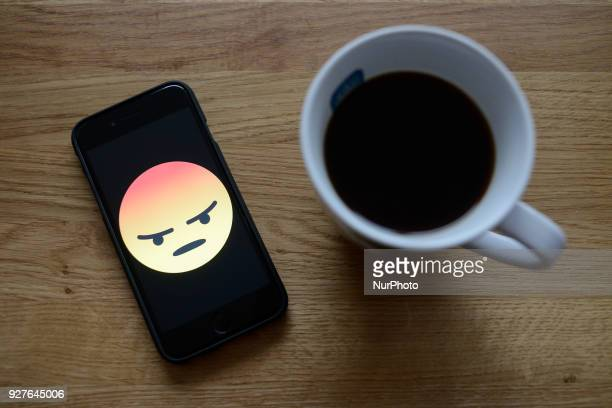 A Facebook angry face is seen on an iphone in this photo illustration on March 5 2018