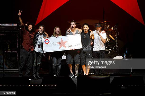 Facebook campaigners Jon and Tracy Morter receive a donation cheque for the royalties earned for the Christmas 2009 number one single by American...