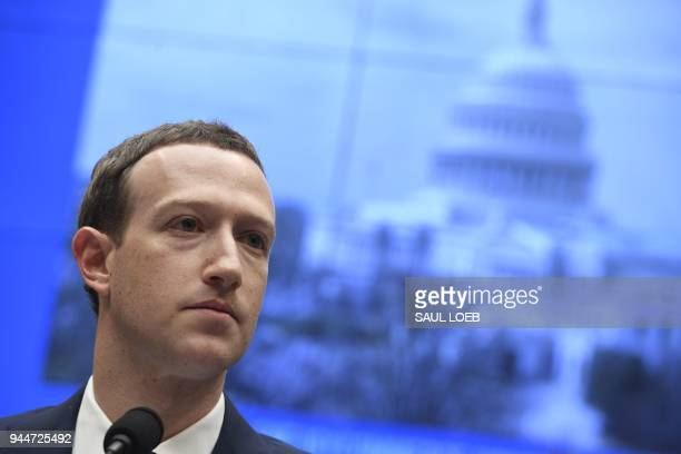 TOPSHOT Facebook CEO and founder Mark Zuckerberg testifies during a US House Committee on Energy and Commerce hearing about Facebook on Capitol Hill...