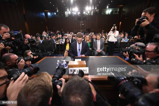 TOPSHOT Facebook CEO Mark Zuckerberg arrives to testify before a joint hearing of the US Senate Commerce Science and Transportation Committee and...