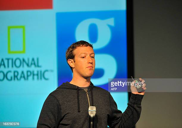 Facebook CEO Mark Zuckerberg controls a slide show as he speaks during a media event at Facebook's Headquarters office in Menlo Park California on...