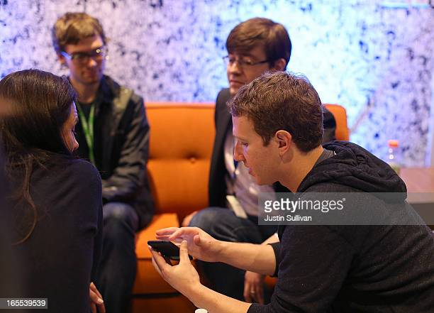 Facebook CEO Mark Zuckerberg demonstrates the new 'Home' program during an event at Facebook headquarters during an event at Facebook headquarters on...