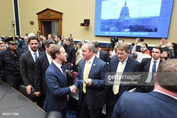 Facebook CEO Mark Zuckerberg is presented a copy of the US Constitution from Congressman Jeff Duncan appears for a hearing with the House Energy and...