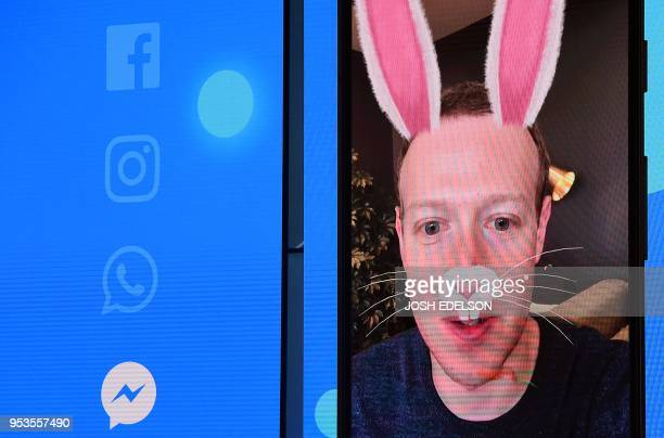 TOPSHOT Facebook CEO Mark Zuckerberg is seen with digital bunny ears onscreen during the annual F8 summit at the San Jose McEnery Convention Center...