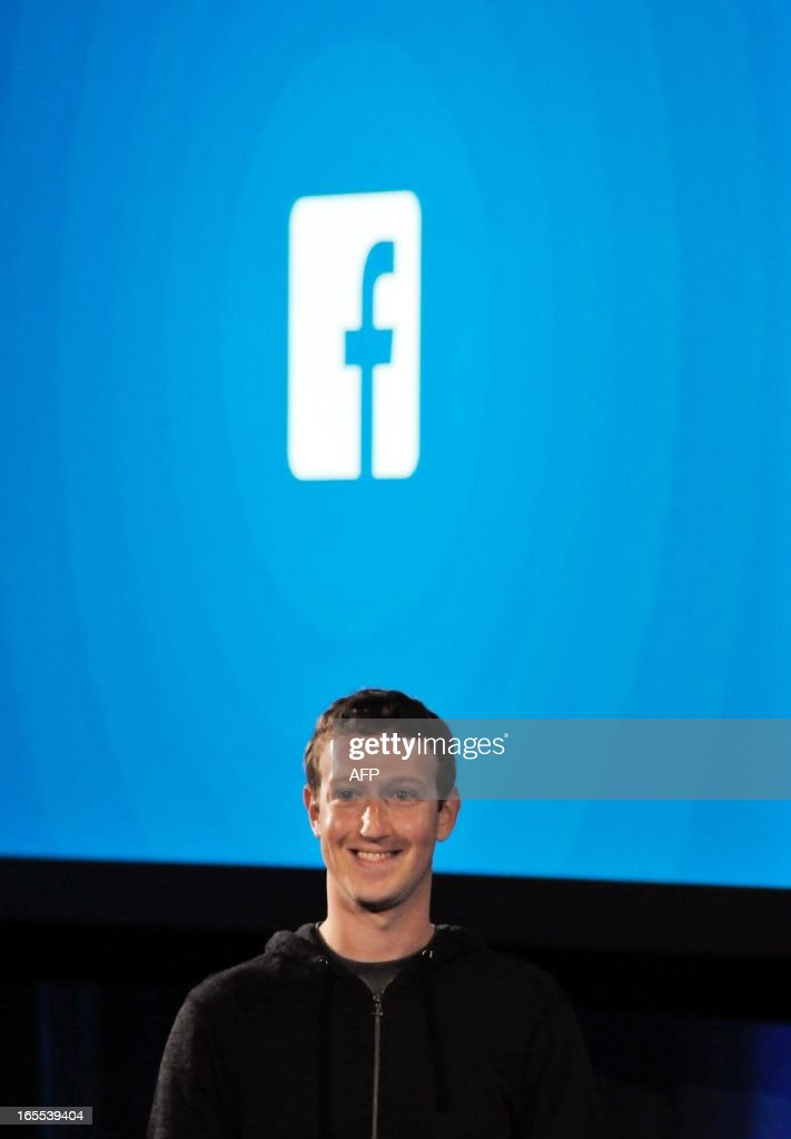 Facebook CEO Mark Zuckerberg speaks during a media event at Facebook's Headquarters office in Menlo Park, California on April 04, 2013. Facebook on Thursday unveiled a software suite which stakes out a 'home' on Android smartphones as it steps up its challenge to Apple and Google in the booming mobile market. Facebook called the new software 'a new way to turn your Android phone into a great, living, social phone.' The software, which allows users to see Facebook's 'Cover Feed' when they turn on their phones, will be available for download from Google's online Play shop in the United States starting April 12, Zuckerberg said. AFP PHOTO / Josh EDELSON / AFP PHOTO / Josh Edelson