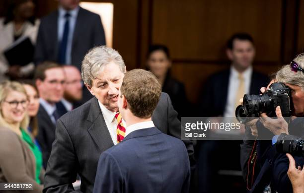 Facebook CEO Mark Zuckerberg speaks with Sen John Kennedy RLa before the start of the Senate Commerce Science and Transportation Committee and Senate...