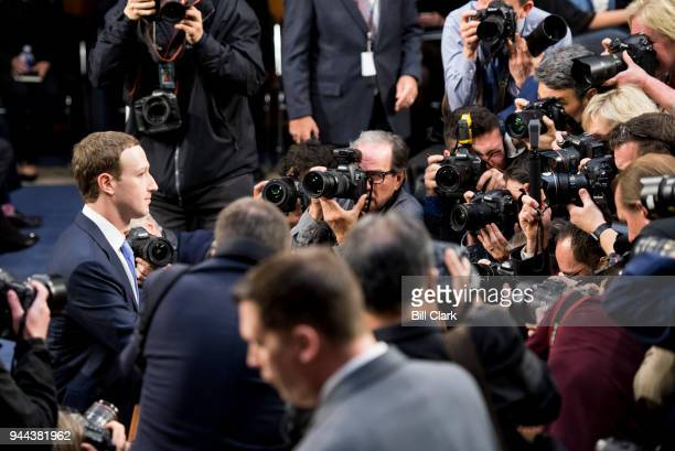 Facebook CEO Mark Zuckerberg takes his seat before the start of the Senate Commerce Science and Transportation Committee and Senate Judiciary...