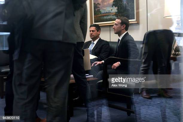 Facebook CEO Mark Zuckerberg waits by the front desk after he arrived at a meeting with US Sen Bill Nelson ranking member of the Senate Committee on...