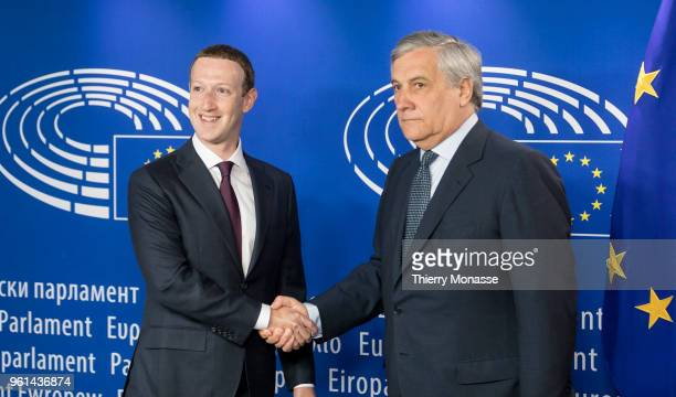 Facebook chief Mark Zuckerberg is welcome by the President of the European Parliament Antonio Tajani prior to their meeting on May 22 2018 in...