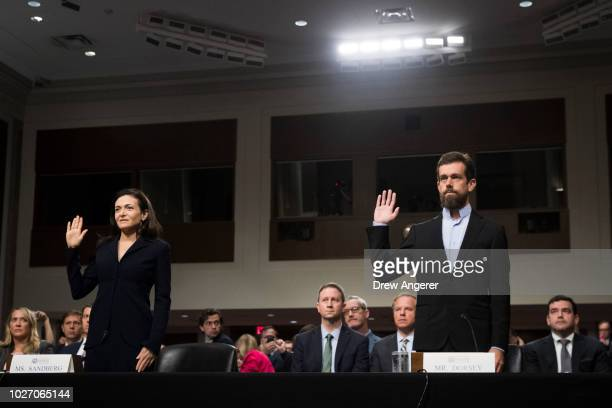Facebook chief operating officer Sheryl Sandberg and Twitter chief executive officer Jack Dorsey are swornin for a Senate Intelligence Committee...