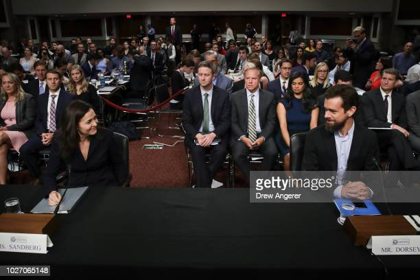Facebook chief operating officer Sheryl Sandberg and Twitter chief executive officer Jack Dorsey arrive for a Senate Intelligence Committee hearing...