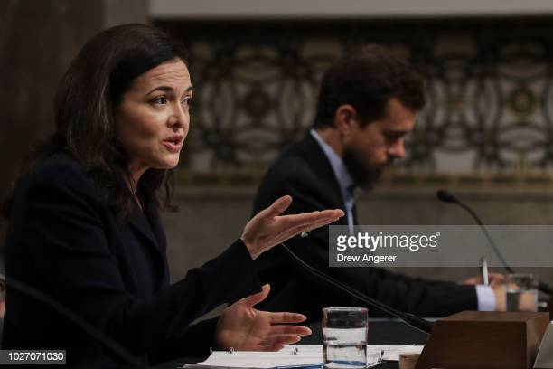 Facebook chief operating officer Sheryl Sandberg and Twitter chief executive officer Jack Dorsey testify during a Senate Intelligence Committee...