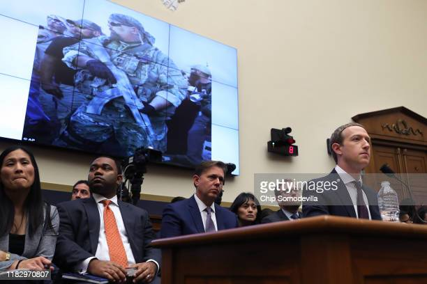 Facebook cofounder and CEO Mark Zuckerberg answers questions about hate groups' use of the social network as he testifies before the House Financial...
