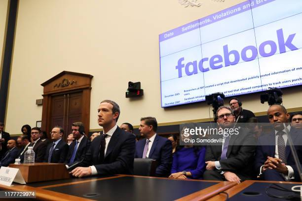 Facebook co-founder and CEO Mark Zuckerberg arrives to testify before the House Financial Services Committee in the Rayburn House Office Building on...