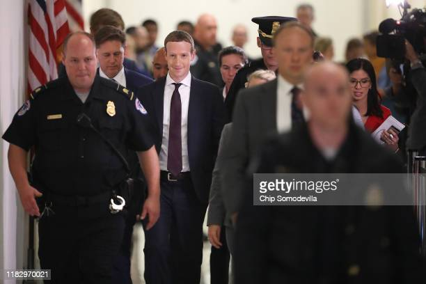 Facebook cofounder and CEO Mark Zuckerberg leaves the Rayburn House Office Building after testifying before the House Financial Services Committee...