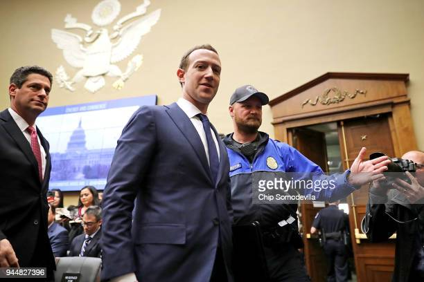 Facebook cofounder Chairman and CEO Mark Zuckerberg leaves during a break in a hearing of the House Energy and Commerce Committee in the Rayburn...