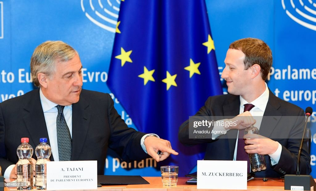 Facebook co-founder, Chairman and CEO Mark Zuckerberg (R) opens a water bottle as he testifies to the European Parliament next to President of the European Parliament, Antonio Tajani (L) in Brussels, Belgium on May 22, 2018.