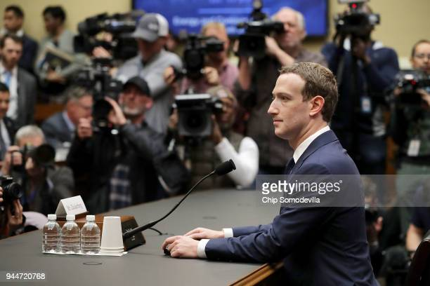Facebook co-founder, Chairman and CEO Mark Zuckerberg prepares to testify before the House Energy and Commerce Committee in the Rayburn House Office...