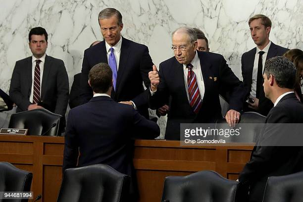 Facebook cofounder Chairman and CEO Mark Zuckerberg shakes hands With Senate Commerce Committee Chairman John Thune and Judiciary Committee Chairman...