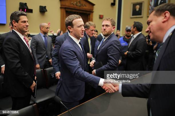 Facebook cofounder Chairman and CEO Mark Zuckerberg shakes hands with House Energy and Commerce Committee member Rep Richard Hudson at the conclusion...