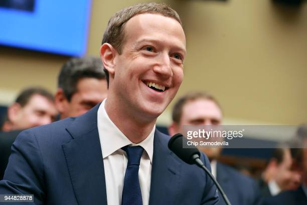 Facebook co-founder, Chairman and CEO Mark Zuckerberg smiles at the conclusion of his testimony before the House Energy and Commerce Committee in the...