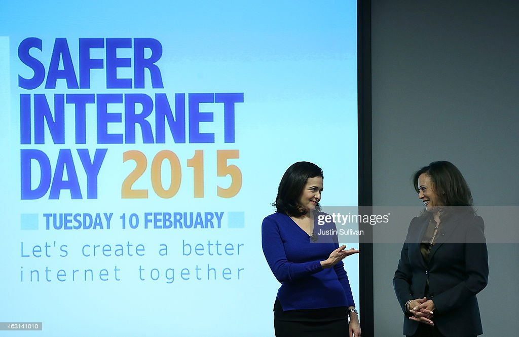 Facebook COO Sheryl Sandberg (L) gestures towards California Attorney General Kamala Harris (R) during a Safer Internet Day event at Facebook headquarters on February 10, 2015 in Menlo Park, California. Harris delivered the keynote speech at the event, designed to promote safe, effective use of the internet and mobile technology. Safer Internet Day is celebrated annually in more than 100 countries on the the second Tuesday in February.