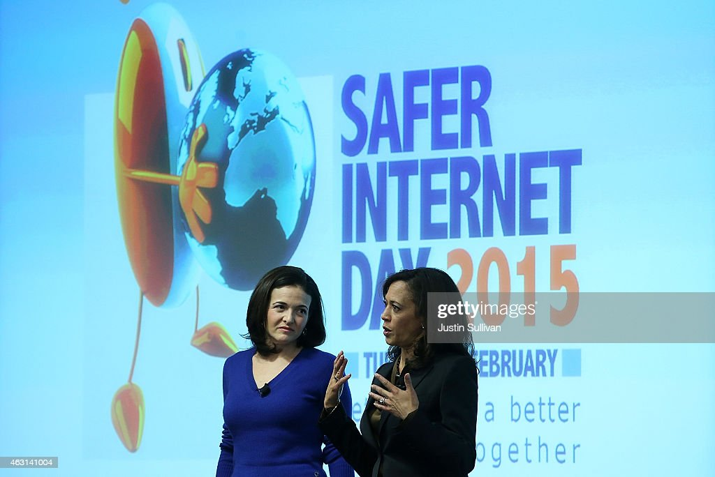 Facebook COO Sheryl Sandberg (L) looks on as California Attorney General Kamala Harris (R) speaks during a Safer Internet Day event at Facebook headquarters on February 10, 2015 in Menlo Park, California. Harris delivered the keynote speech at the event, designed to promote safe, effective use of the internet and mobile technology. Safer Internet Day is celebrated annually in more than 100 countries on the the second Tuesday in February.