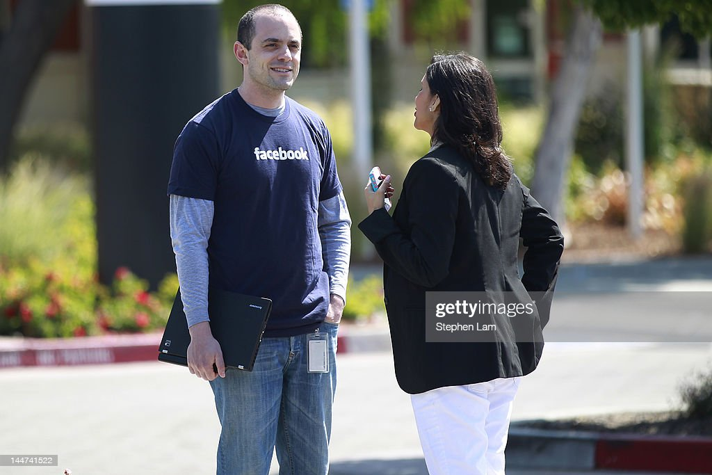 Facebook employee David Fisch (L) speaks with a reporter outside Facebook headquarters May 18, 2012 in Menlo Park, California. The eight-year-old social network company listed their initial public offering on NASDAQ Friday morning at $38 a share and a valuation of $104 billion, making its IPO the third largest in U.S. history after General Motors and Visa.