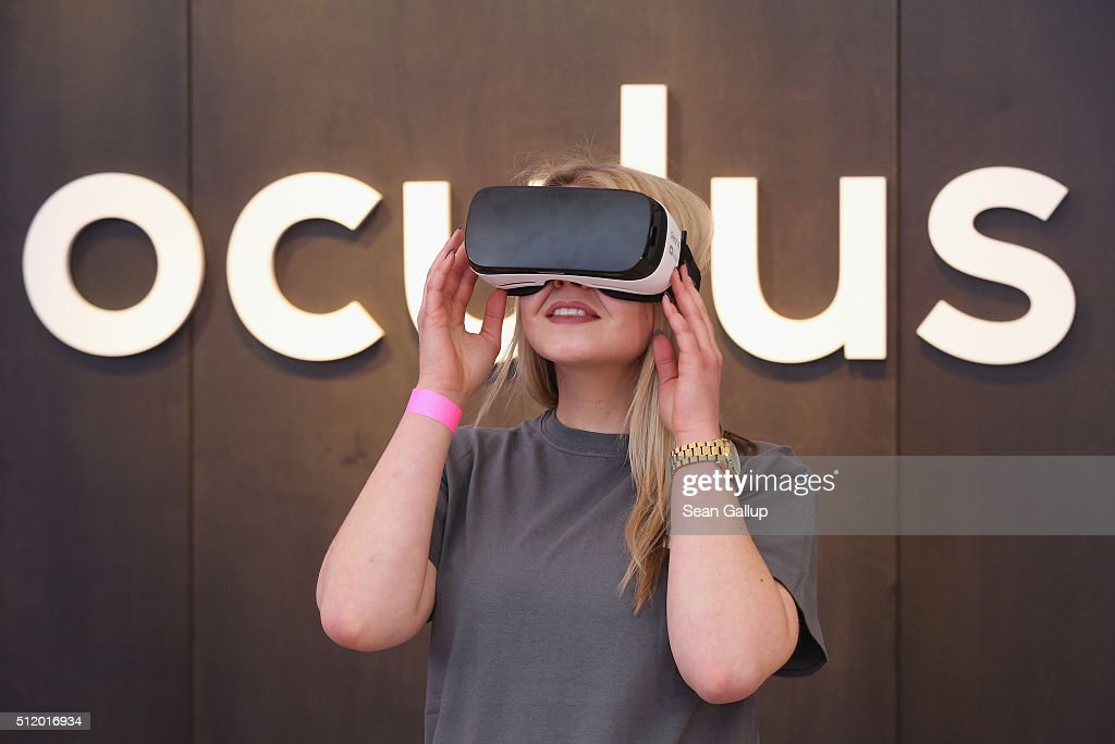 A Facebook employee demonstrates use of the Oculus Gear VR virtual reality goggles at the Facebook Innovation Hub on February 24, 2016 in Berlin, Germany. The Facebook Innovation Hub is a temporary exhibition space where the company is showcasing some of its newest technologies and projects.