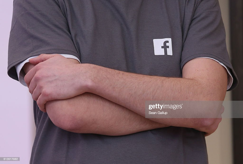 AA Facebook employee wearing a t-shirt adorned with a Facebook logo stands at the Facebook Innovation Hub on February 24, 2016 in Berlin, Germany. The Facebook Innovation Hub is a temporary exhibition space where the company is showcasing some of its newest technologies and projects.