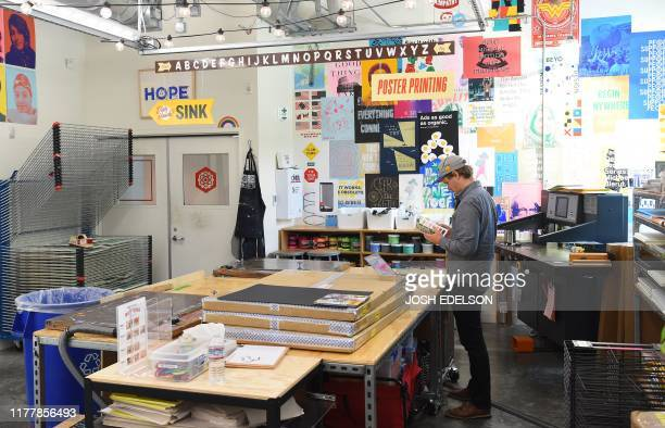 Facebook employee works at a print shop at the company's corporate headquarters campus in Menlo Park, California, on October 23, 2019.