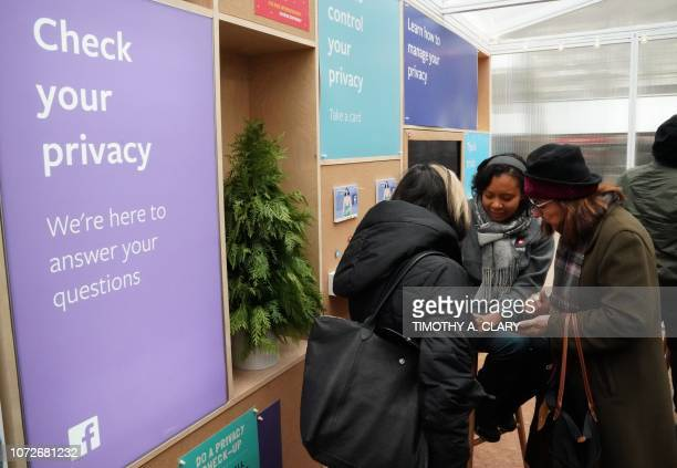 Facebook employees talks to visitors as the social network Facebook opens a popup kiosk for one day on December 13 in Bryant Park in New York where...