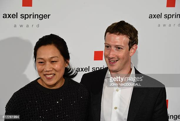 Facebook founder and CEO Mark Zuckerberg arrives to receive the Axel Springer Award with his wife Priscilla Chan in Berlin on February 25 2016...