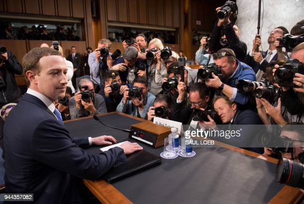 Facebook founder and CEO Mark Zuckerberg arrives to testify during a Senate Commerce Science and Transportation Committee and Senate Judiciary...