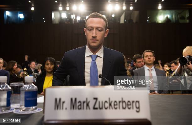 Facebook founder and CEO Mark Zuckerberg arrives to testify following a break during a Senate Commerce Science and Transportation Committee and...