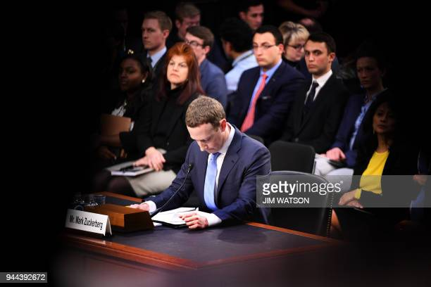 TOPSHOT Facebook founder and CEO Mark Zuckerberg testifies during a Senate Commerce Science and Transportation Committee and Senate Judiciary...