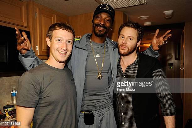 Facebook founder Mark Zuckerberg rapper Snoop Dogg and entrepreneur Sean Parker pose backstage at Sean Parker's Celebration of Music on September 22...