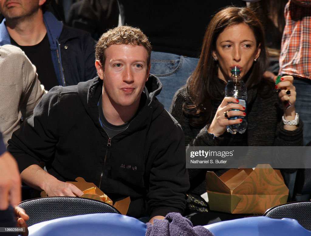 Facebook founder Mark Zuckerberg (left) watches the game action between the Dallas Mavericks and New York Knicks on February 19, 2012 at Madison Square Garden in New York City.