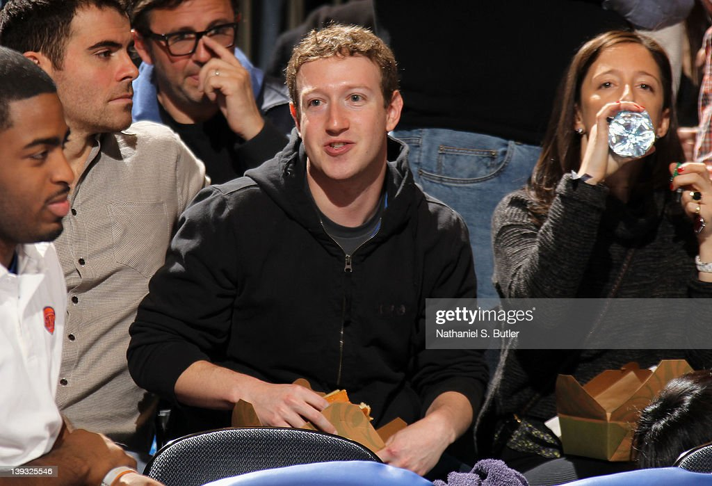 Facebook founder Mark Zuckerberg (center) watches the game action between the Dallas Mavericks and New York Knicks on February 19, 2012 at Madison Square Garden in New York City.