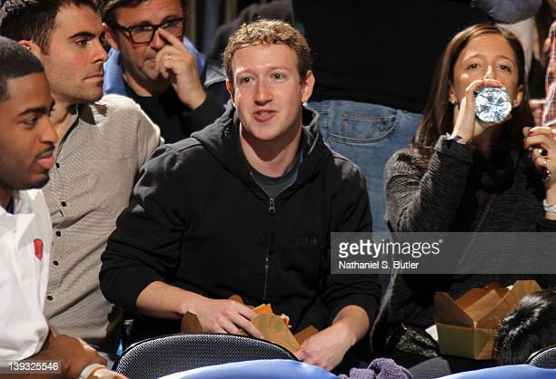 Facebook founder Mark Zuckerberg watches the game action between the Dallas Mavericks and New York Knicks on February 19 2012 at Madison Square...