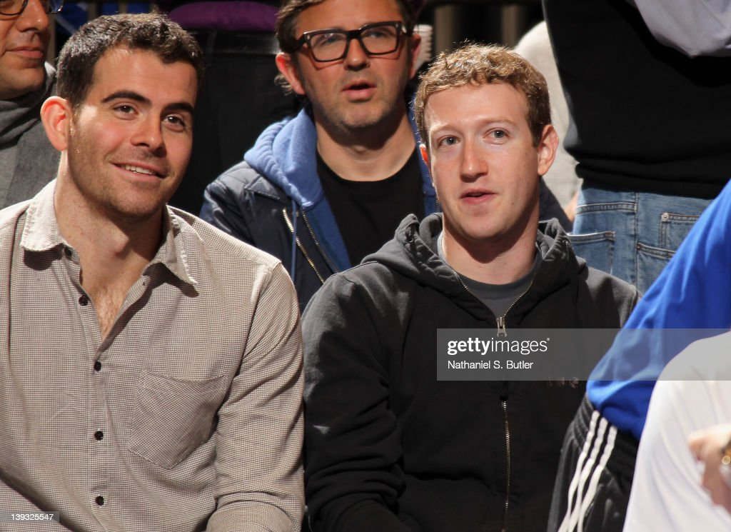 Facebook founder Mark Zuckerberg (right) watches the game action between the Dallas Mavericks and New York Knicks on February 19, 2012 at Madison Square Garden in New York City.