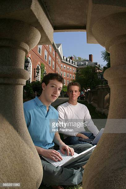 Facebook founders Mark Zuckerberg and Chris Hughes on the Harvard University campus three months after launching Facebook from their Harvard dorm room