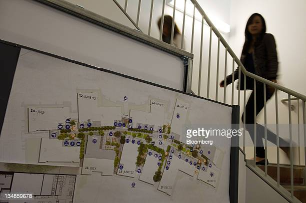 Facebook Inc employees pass a diagram of the company's new campus in Menlo Park California US on Friday Dec 2 2011 Facebook hopes to accommodate over...