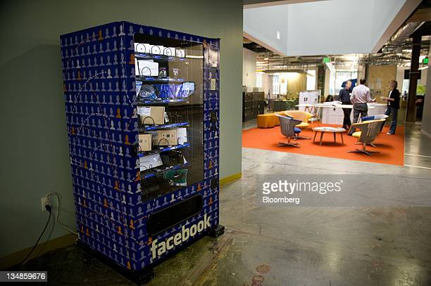 Facebook Inc employees talk in a break area at the company's new campus in Menlo Park California US on Friday Dec 2 2011 Facebook hopes to...