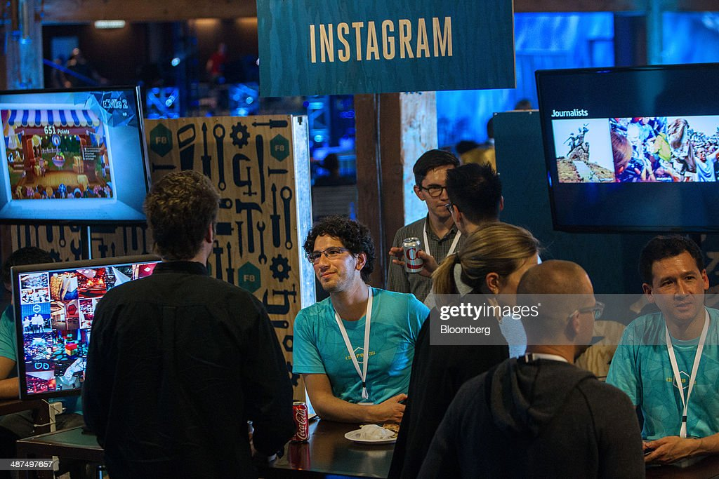 Facebook Inc. employees talk to attendees about Instagram during the company's F8 Developers Conference to begin in San Francisco, California, U.S., on Wednesday, April 30, 2014. Facebook Inc. will offer software developers improved tools to create programs that run on any smartphone and a more streamlined experience for people to log into apps, including the option to sign in anonymously. Photographer: Erin Lubin/Bloomberg via Getty Images