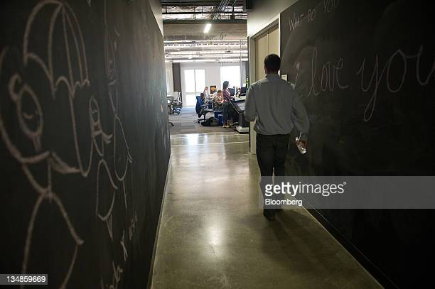 Facebook Inc employees work at the company's new campus in Menlo Park California US on Friday Dec 2 2011 Facebook hopes to accommodate over 6000...