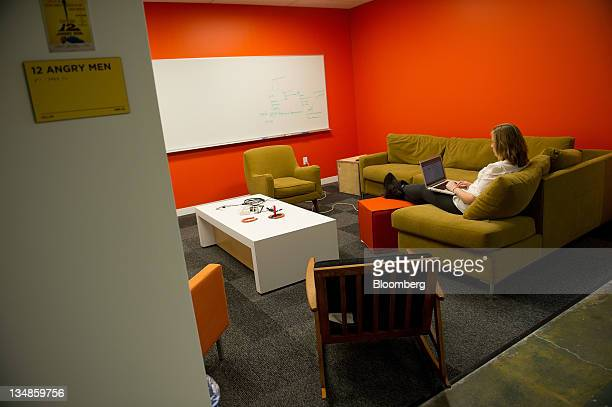 A Facebook Inc employees works in a communal area on the company's new campus in Menlo Park California US on Friday Dec 2 2011 Facebook hopes to...