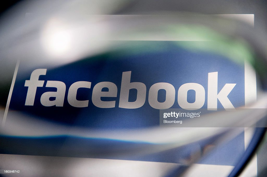 A Facebook Inc. logo is displayed for a photograph in Tiskilwa, Illinois, U.S., on Tuesday, Jan. 29, 2013. Facebook Inc. is scheduled to report quarterly earnings on Jan. 30. Photographer: Daniel Acker/Bloomberg via Getty Images